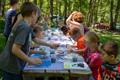 Children paint during the first session of the Backbone Rally.